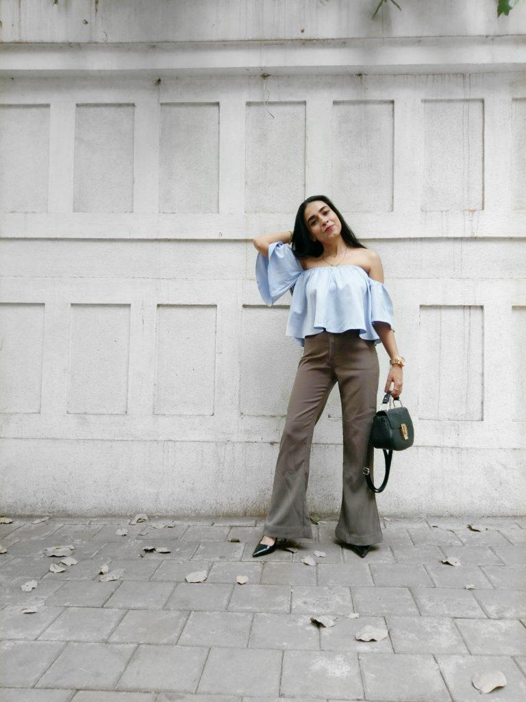 Sleeves, fashion blue top, khaki pants, leather sling bag, fashion week