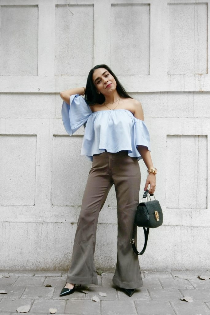 Sleeves, fashion blue top, khaki pants, leather sling bag, fashion week