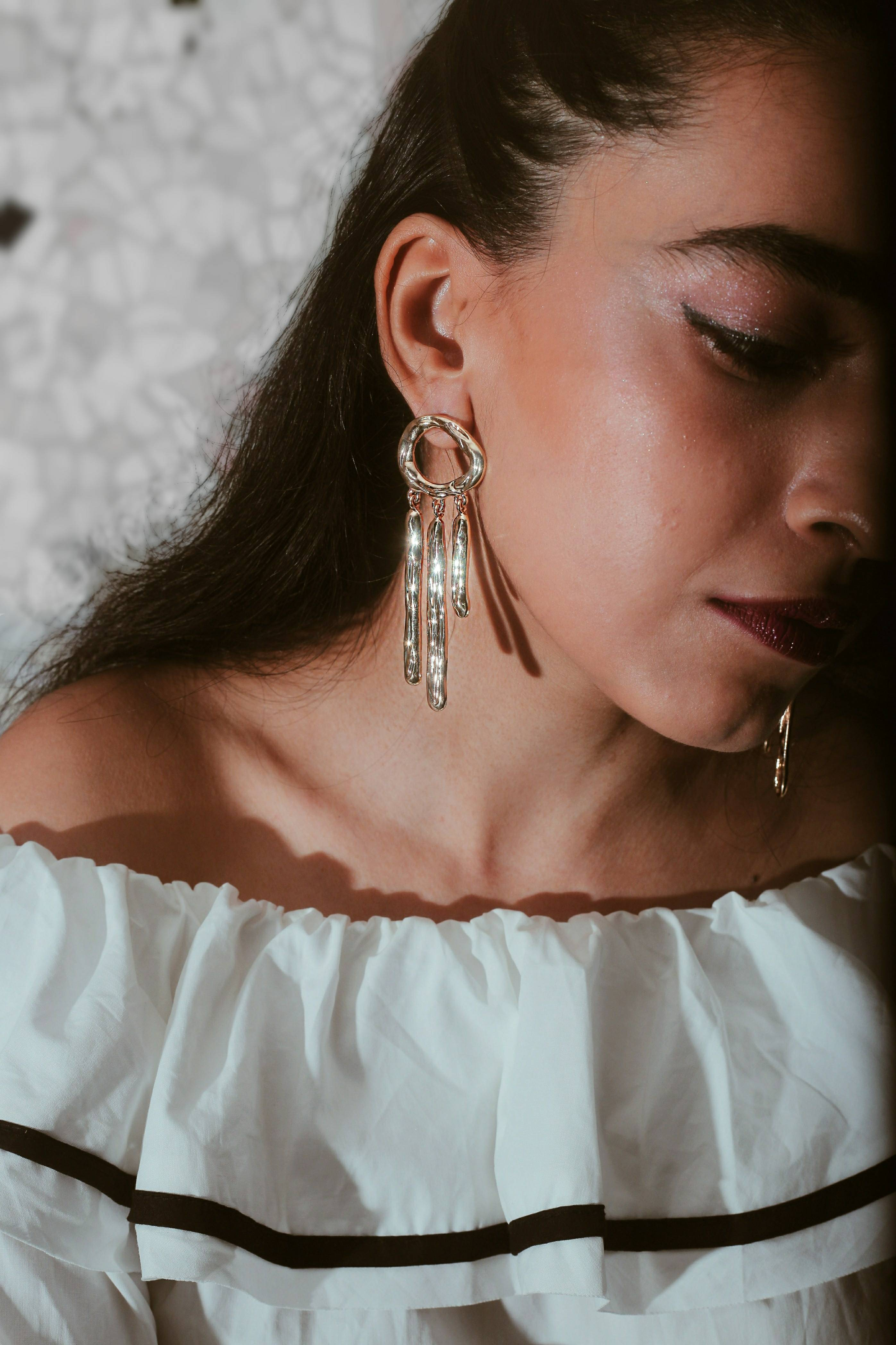 Earrings, jewelry, accessories, statement piece, statement jewelry, jewellery, makeup, editorial shoot, contouring, gold jewelry, minimal, miss match earrings