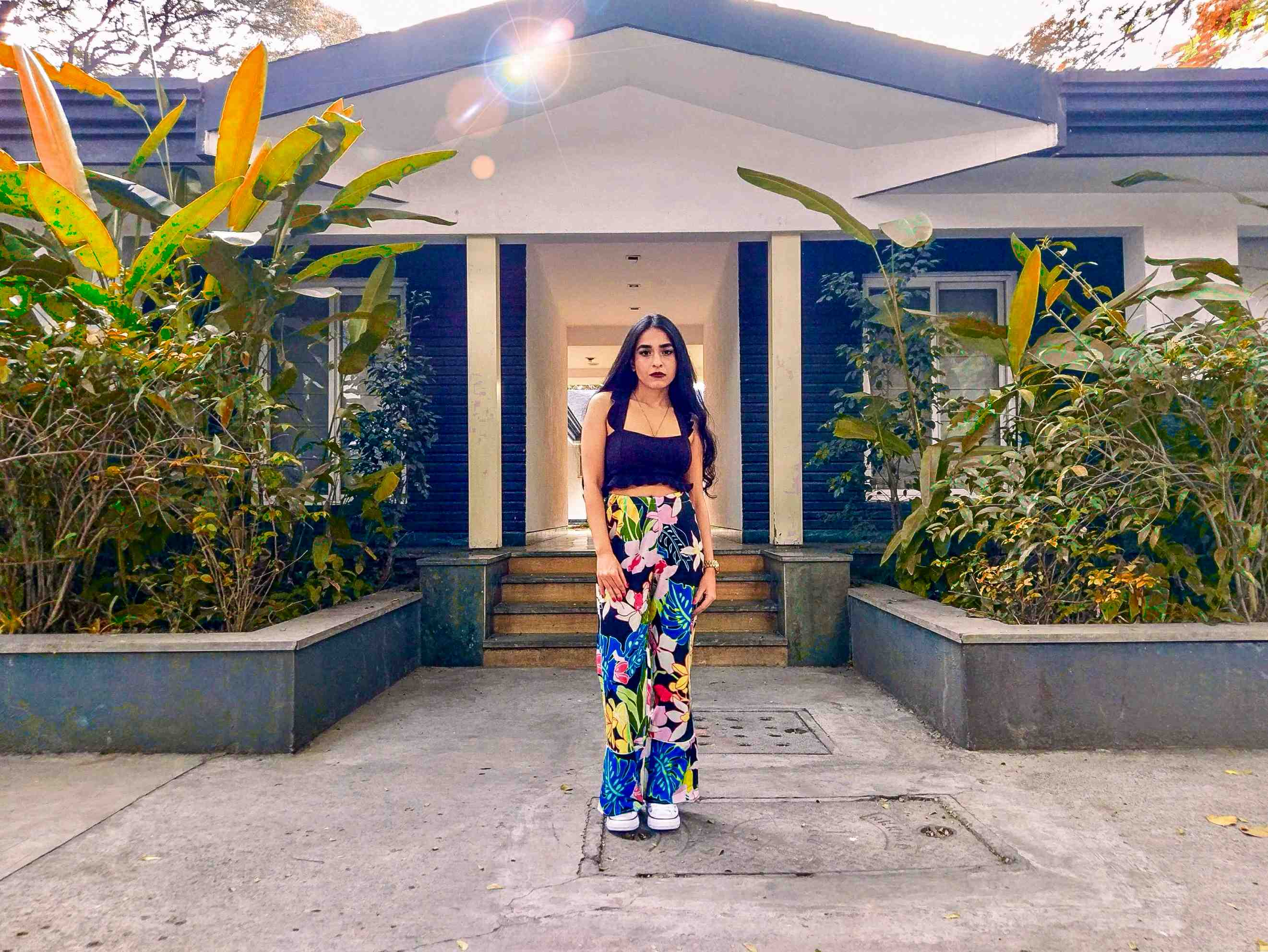 tropical print pants, floral pants colorful ootd black crop top converse beach ootd indian blogger fashion blogger travel blogger fashion week style